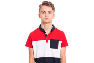 Fototapete - Handsome teen boy isolated on white background. Photo of adorable young child looking at camera, front view. Emotional portrait of caucasian teenager.