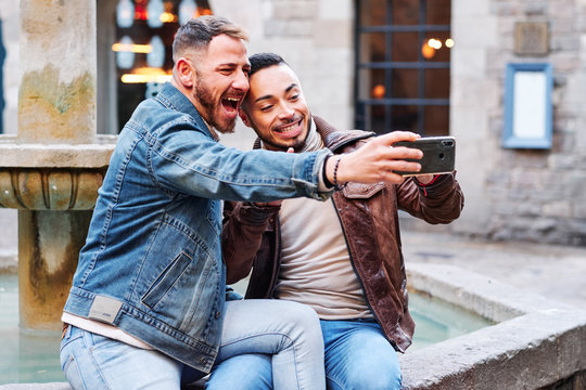a gay couple at Barcelona making a selfie - gay concept