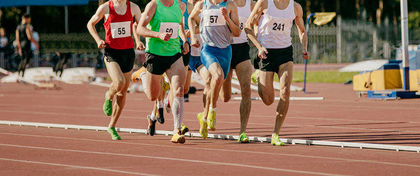 group male runners running middle distance race