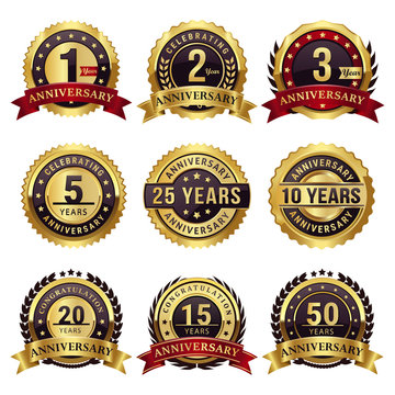 set of anniversary gold badges and labels