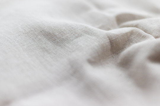 Natural linen fabric texture. Rough crumpled burlap background. Selective focus. Closeup view