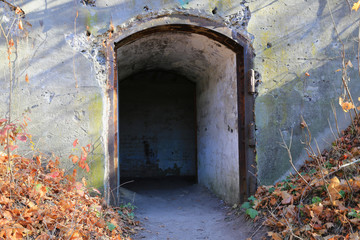 Fototapete - Ruins of the entrance to the abandoned dungeon