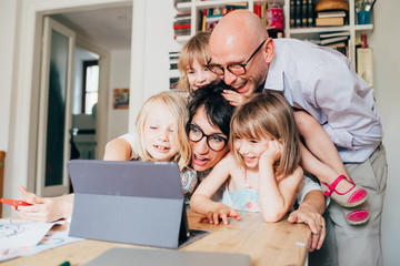 family with three children indoor using tablet - togetherness, technology, entertainment concept