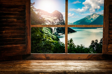 Wooden window sill background with pillows and free space for your decoration.Landscape of spring...