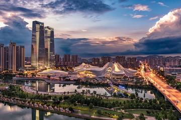 Fotomurales - AERIAL VIEW OF ILLUMINATED BRIDGE AND BUILDINGS AGAINST SKY