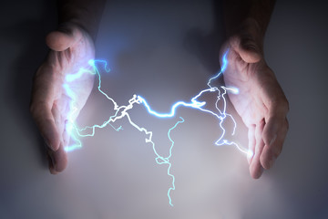 Energy and lightning in hands of healer or magician.