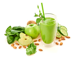 Freshly blended green fruit smoothie in glass, healthy detox vitamin diet or vegan food concept. Raw fresh vitamins smoothie breakfast drink with spinach, apple, isolated on white.