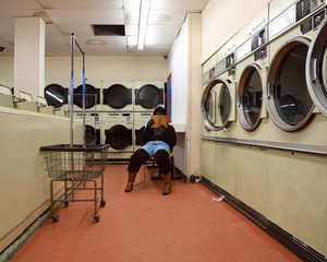 Gorilla Person Reading Book at Laundrymat Alone