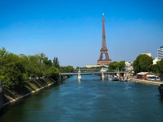 Wall Murals Paris Eiffel Tower By River Against Blue Sky