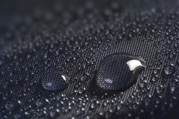 Many water drops on waterproof impregnated fabric.