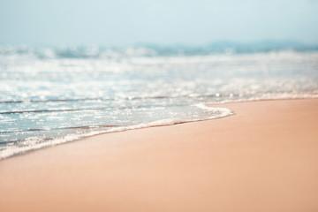 Foto op Plexiglas Strand Close-up soft wave of the sea on the sandy beach