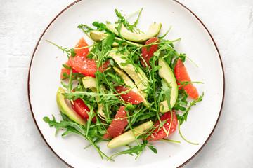 Detox grapefruit and arugula salad, top down view