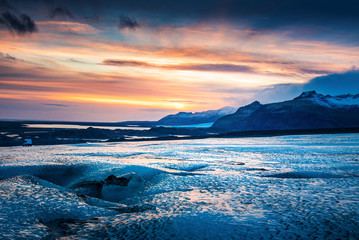 Beautiful sunset over the Icelandic glacier in south Iceland