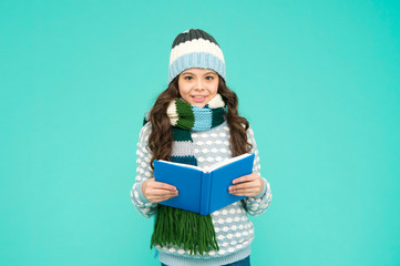 Winter story. Girl reading book. Kid enjoying book. Little book lover. My favorite story. Leisure...