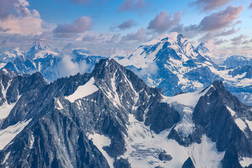 Cloudy skies over the French Alps below Mont Blanc