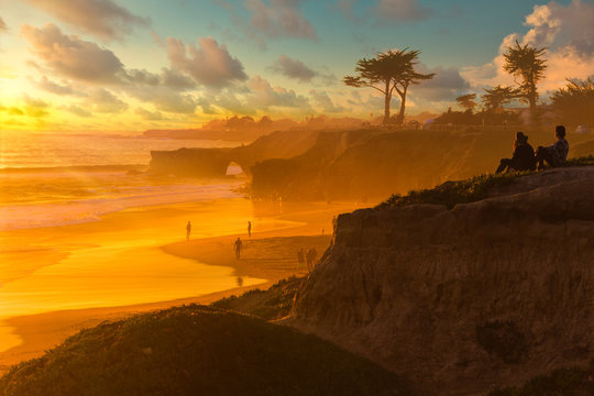 Colorful sunset over Natural Bridges beach in Santa Cruz California