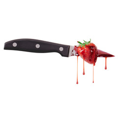 Strawberry stabbed by a knife and bleeding