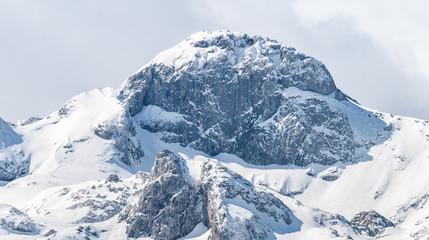 Snow peaks at Peaks of Europe from Covadonga lakes