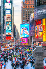 New York City - USA - MARCH 25, 2012: Times Square,is a busy tourist intersection of neon art and commerce and is an iconic street of New York City and America.
