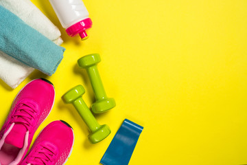 Fitness equipment flat lay image on color background.