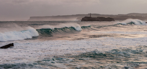 Cantabric Sea with angry waves over Mouro Island from the beach