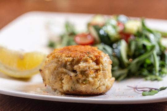 crabcake dinner on plate in restaurant
