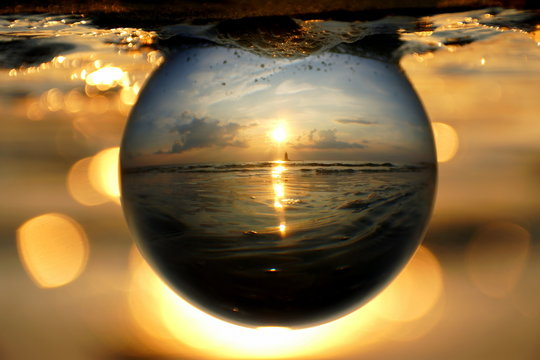 Beautiful sunset captured through a glass lens ball at Cape Henlopen State Park, Lewes, Delaware, U.S.A