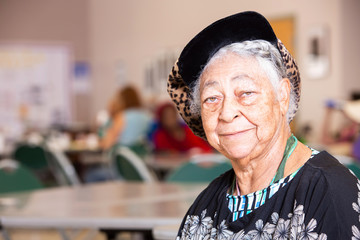 Horizontal Shot of Smiling African American Woman in a Senior Center