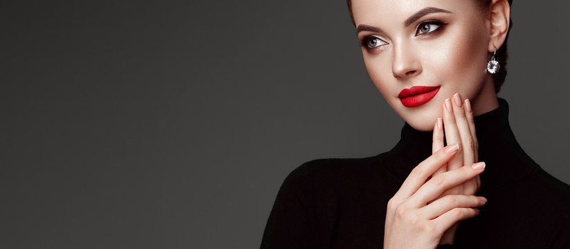 Beautiful Young Woman with Clean Fresh Skin. Perfect Makeup. Beauty Fashion. Red Lips. Cosmetic Eyeshadow. Girl in Black Turtleneck