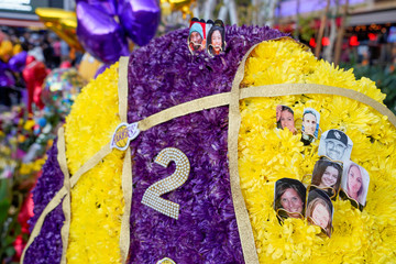 Photos of those killed sit upon flowers in Microsoft Square near the Staples Center to pay respects to Kobe Bryant after a helicopter crash killed the retired basketball star