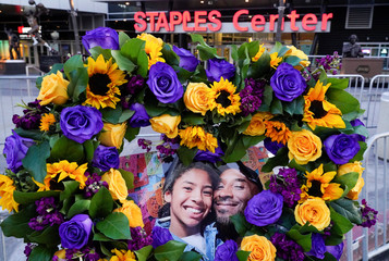 Flowers and photos of Kobe and Gigi placed near the Staples Center to pay tribute to Kobe Bryant after a helicopter crash killed the retired basketball star, in Los Angeles