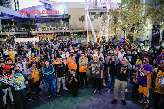 "Fans shoot a hoops yelling ""Kobe"" in Microsoft Square near the Staples Center to pay respects to Kobe Bryant after a helicopter crash killed the retired basketball star, in Los Angeles"