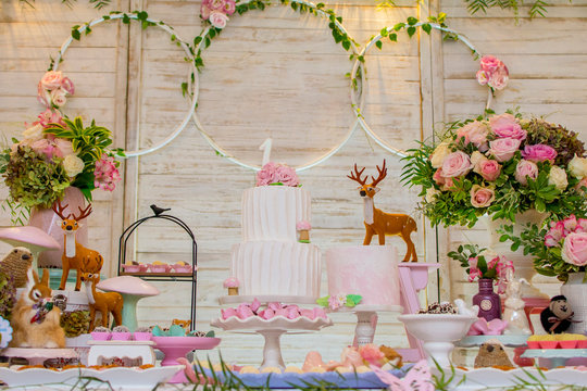 Luxurious table of sweets and birthday cake