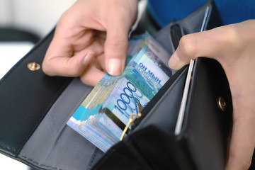 Tenge, the national currency in the wallet.