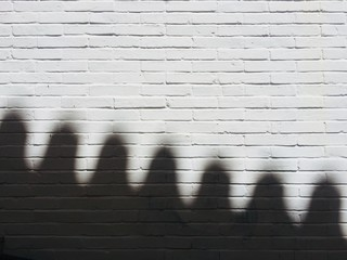 Close-Up Of Shadow On Brick Wall