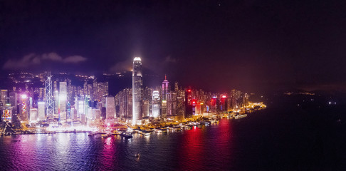 Fototapete - Amazing night aerial view of cityscape of Victoria Harbour, center of Hong Kong, asia
