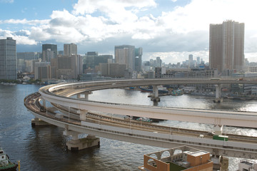 Rainbow Bridge loop and Tokyo skyline 東京レインボーブリッジのループ橋と湾岸沿いのビル群
