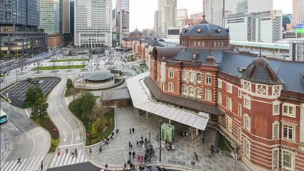 Wall Mural - Day to night time lapse in Tokyo city with view of Tokyo train station in Japan