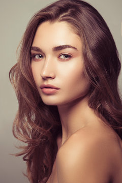 Portrait of a beautiful girl with natural makeup. Beauty style shot. Clean skin and hair. Close up.