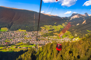 Aerial view of Ortisei mountain village from cableway. Dolomites, South Tyrol, Italy.