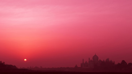 Foto op Plexiglas Candy roze Silhouette of majestic ancient Taj Mahal temple at sunrise; UNESCO world heritage, bank of the Yamuna river in Agra, India