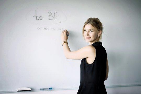 blonde teacher teaching a lesson
