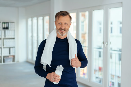 Fit healthy mature man after a workout at work