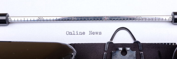 Online News - written on an old typewriter, vintage newsletter bulletin