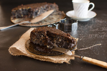 Poppy seed cake with nuts and raisins topped with dark chocolate..