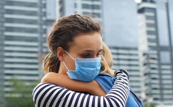 Parent hugs the child. Fighting the 2019-nCoV Virus Outbreak