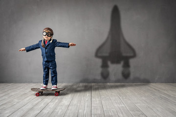 Happy child wants to fly. Imagination, freedom and motivation concept