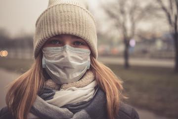 Coronavirus MERS-CoV Chinese infection  Virus masked girl on the background of the city in smog, the concept of the epidemic of the virus in China coronavirus nCov