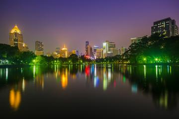 Wall Murals Kuala Lumpur ILLUMINATED BUILDINGS BY RIVER AGAINST SKY AT NIGHT