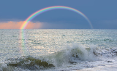 Wall Mural - Storm on the sea with amazing rainbow at sunset